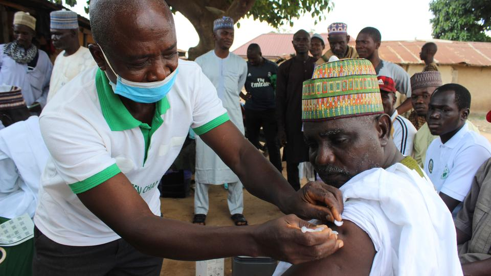 Yusuf Halilu Bisalla, deputy imam of Kuje Central Mosque is administered a Moderna Covid-19 vaccination outside the Kuje, Central Mosque outskirts of Abuja on October 8, 2021.