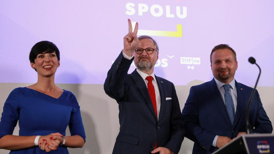 Leader of Civic Democratic Party (ODS) and Together (SPOLU) coalition candidate for prime minister, Petr Fiala, gestures next to leader of KDU-CSL Marian Jurecka and leader of TOP 09 party Marketa Pekarova Adamova, at the party's election headquarters, in Prague, Czech Republic, October 9, 2021.