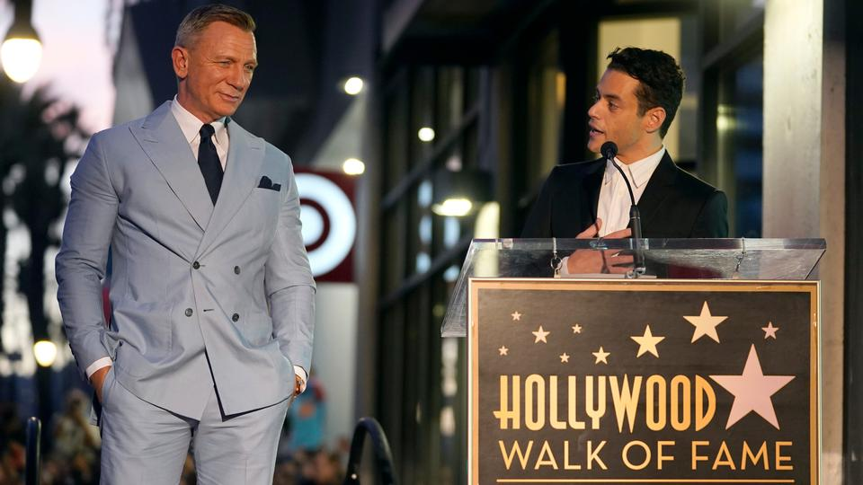 Rami Malek speaks as Daniel Craig looks on during a ceremony honoring Craig with a star on the Hollywood Walk of Fame in Los Angeles on October 6, 2021.
