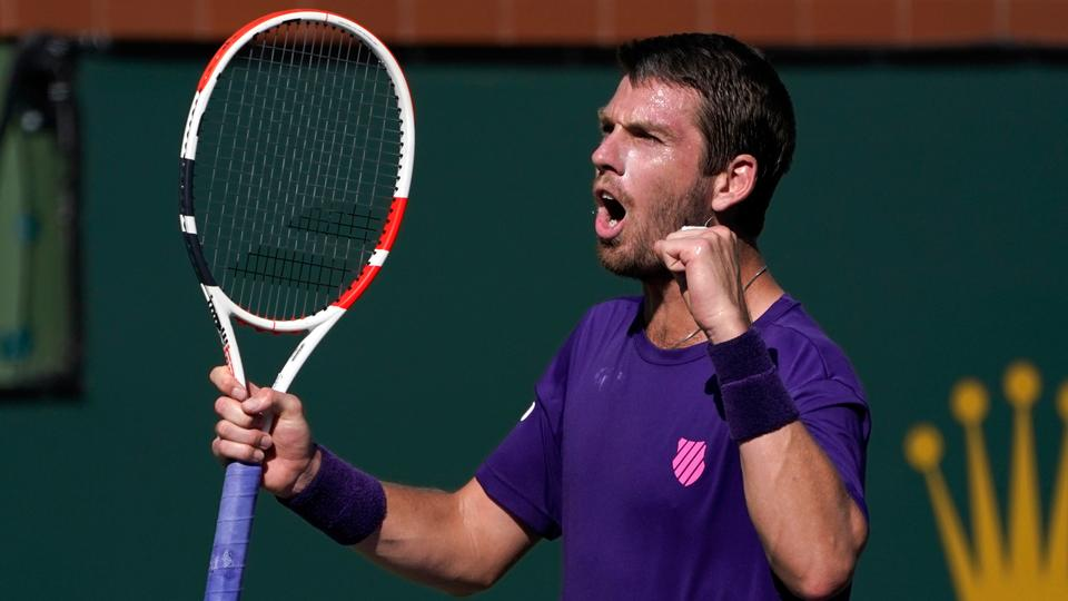 Cameron Norrie, of Britain, reacts to beating Grigor Dimitrov, of Bulgaria, in a semifinal match at the BNP Paribas Open tennis tournament, October 16, 2021, in Indian Wells, California.