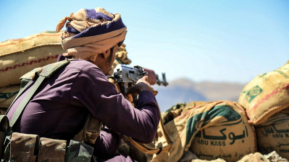 A fighter loyal to Yemen's Saudi-backed government mans a position near the frontline facing Iran-backed Houthi rebels in the country's northeastern province of Marib, on October 17, 2021.