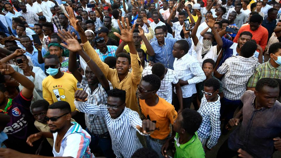 Sudanese protesters take to the streets in the capital Khartoum during a demonstration demanding the dissolution of the transitional government, on October 20, 2021.