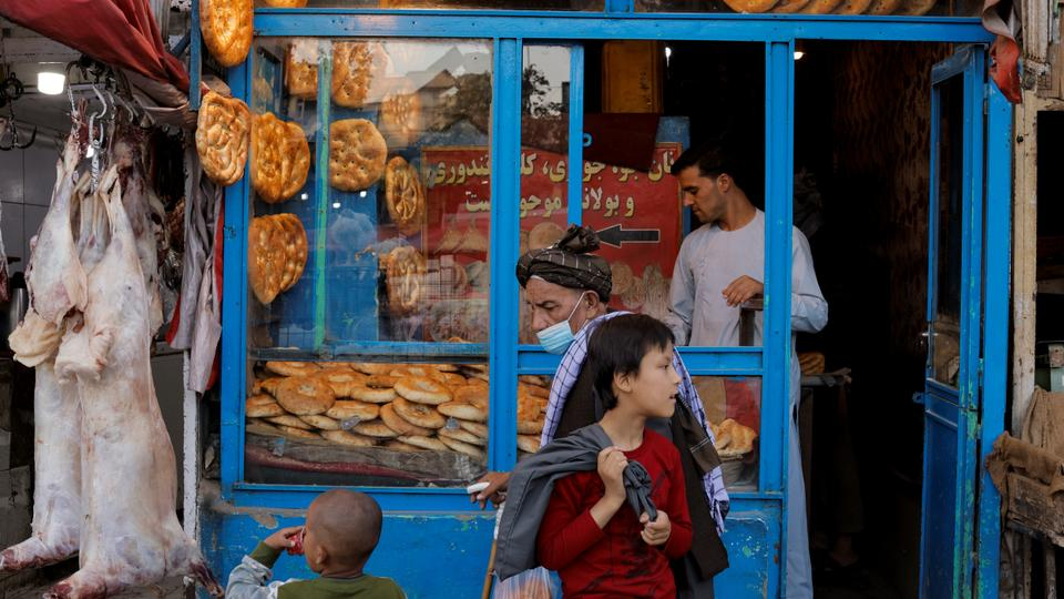 People walk in front of a bakery in Kabul, Afghanistan on October 4, 2021