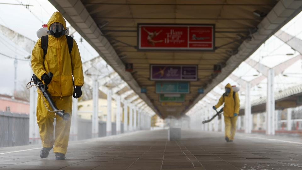 Specialists wearing personal protective equipment spray disinfectant while sanitizing the Leningradsky railway station in Moscow, Russia on October 19, 2021.