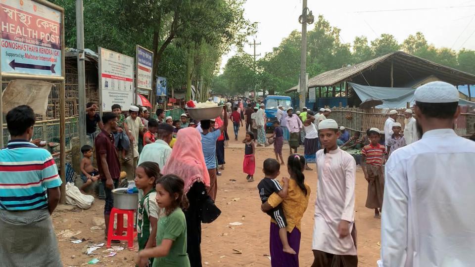 Rohingya refugees walk at the Kutupalong Rohingya refugee camp at Ukhiya in Cox's Bazar district, Bangladesh, October 10, 2021.