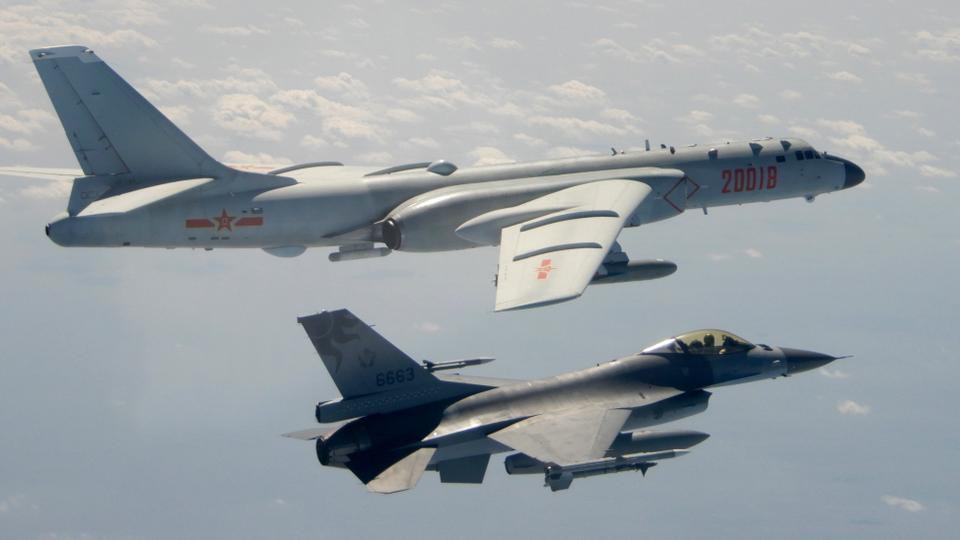 In this February 10, 2020, file photo, a Taiwanese Air Force F-16 in foreground flies on the flank of a Chinese Air Force H-6 bomber as it passes near Taiwan.