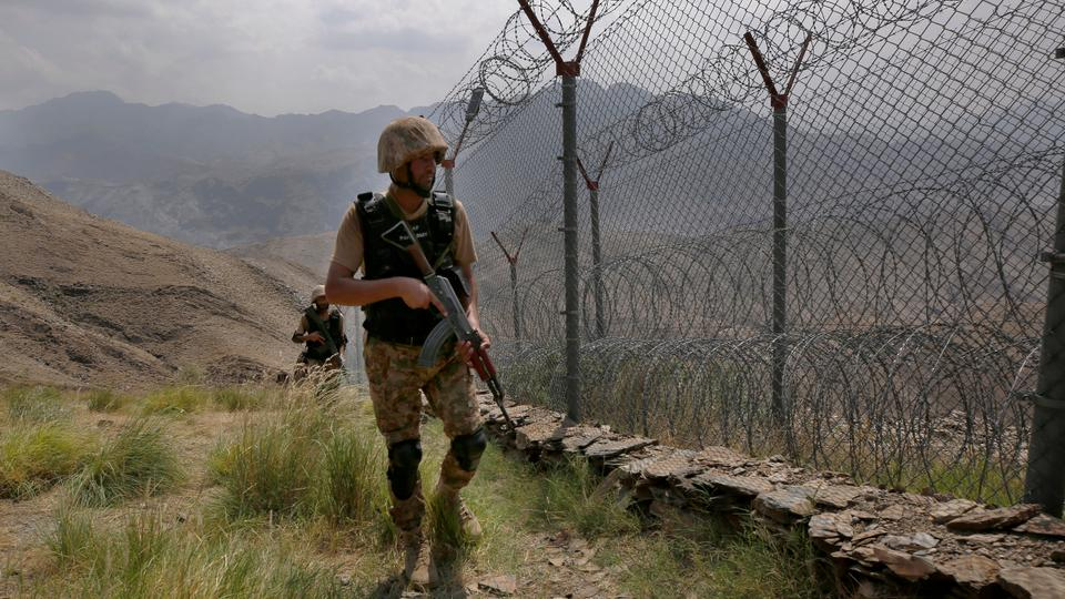 Pakistan Army troops patrol along the fence on the Pakistan Afghanistan border at Big Ben hilltop post in Khyber district, Pakistan.