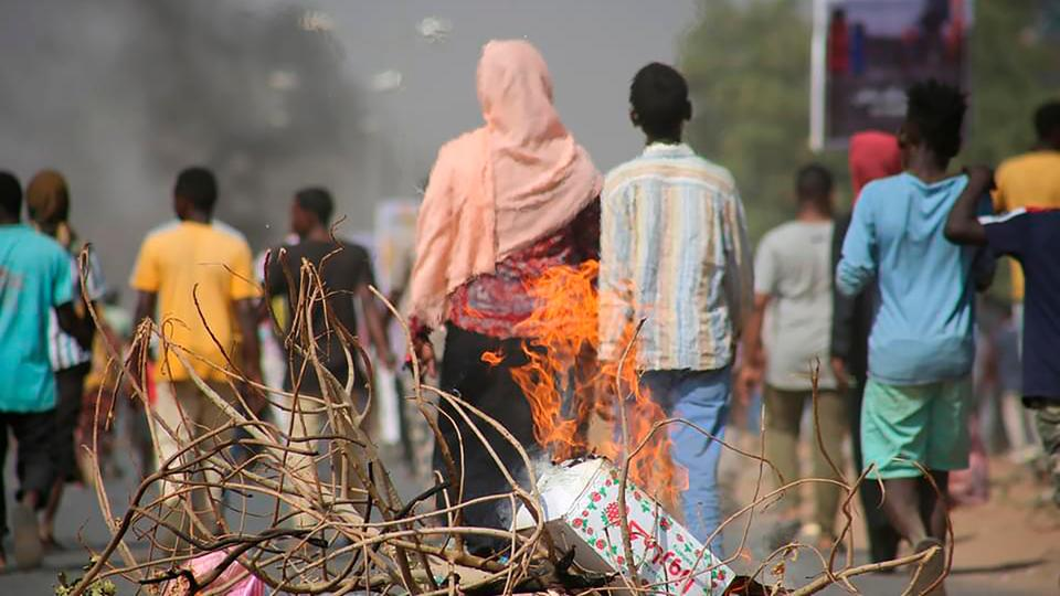 Anti-coup protesters have blocked roads in the capital Khartoum.