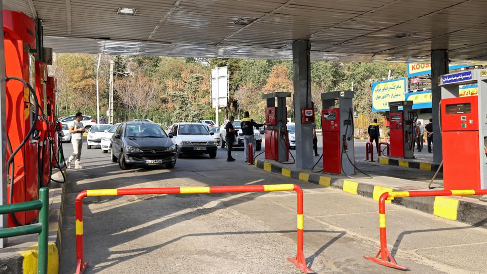 Cars have been queuing to fill up at some gas stations in Iran, while other stations have been abandoned, amid a nationwide disruption of the petrol distribution system.