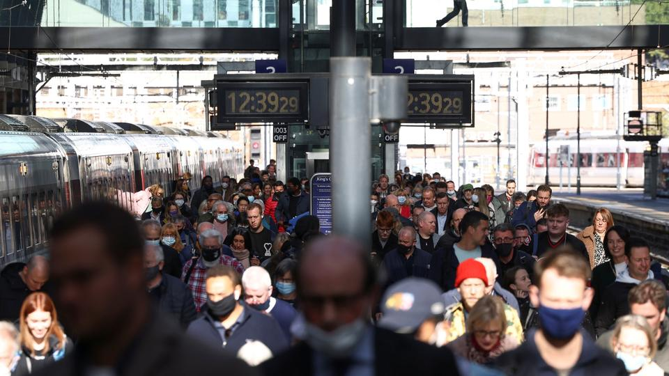 People walk along a platform after departing from a train at King's Cross Station, amid the coronavirus disease outbreak in London, UK.