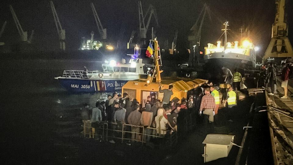 In this image provided by the Romanian border police, a ship carrying 153 migrants docks in the Black Sea port of Constanta on September 13. (AP)