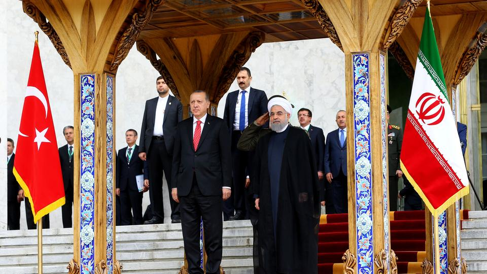 Turkish President Tayyip Erdogan is seen with Iranian President Hassan Rouhani during a welcoming ceremony in Tehran, Iran, October 4, 2017.