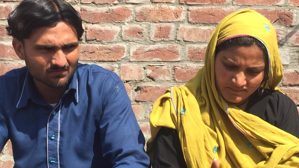 Saba Maqsood (R) and her husband Muhammad Qaiser at their house in Gujranwala, Pakistan, after her family's first attempt on her life for marrying a man of her choice. October 2014.