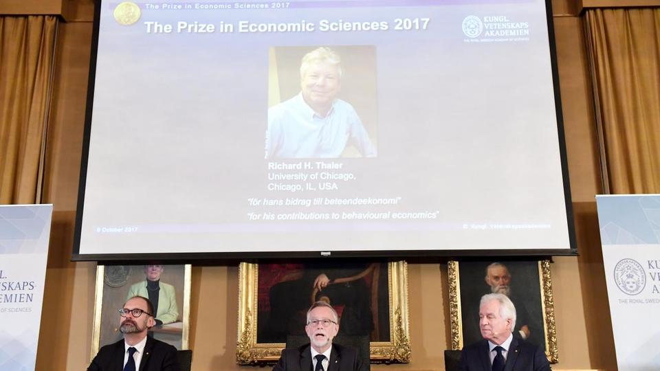 Photo of Richard H. Thaler is displayed on the screen during the announcement of the winner of the Nobel Prize in economic sciences 2017, during a press conference in Stockholm, Sweden, October 9, 2017.