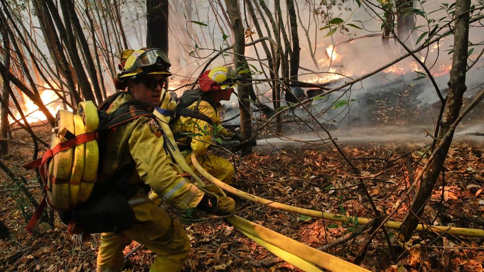 Firefighters put out a hot spot from a wildfire near Calistoga, California, US on Thursday, October 12, 2017. (Photo AP)