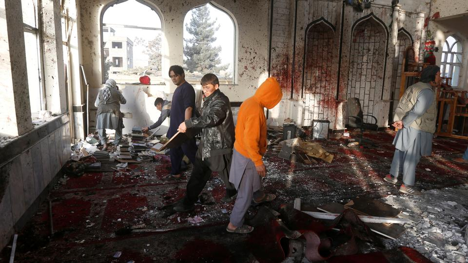 Afghan men inspect inside a Shia Muslim mosque after a suicide attack in Kabul.