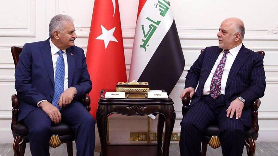Turkish Prime Minister Binali Yildirim (left) and his Iraqi counterpart Haider al-Abadi hold talks in Baghdad, Jan 7, 2017.