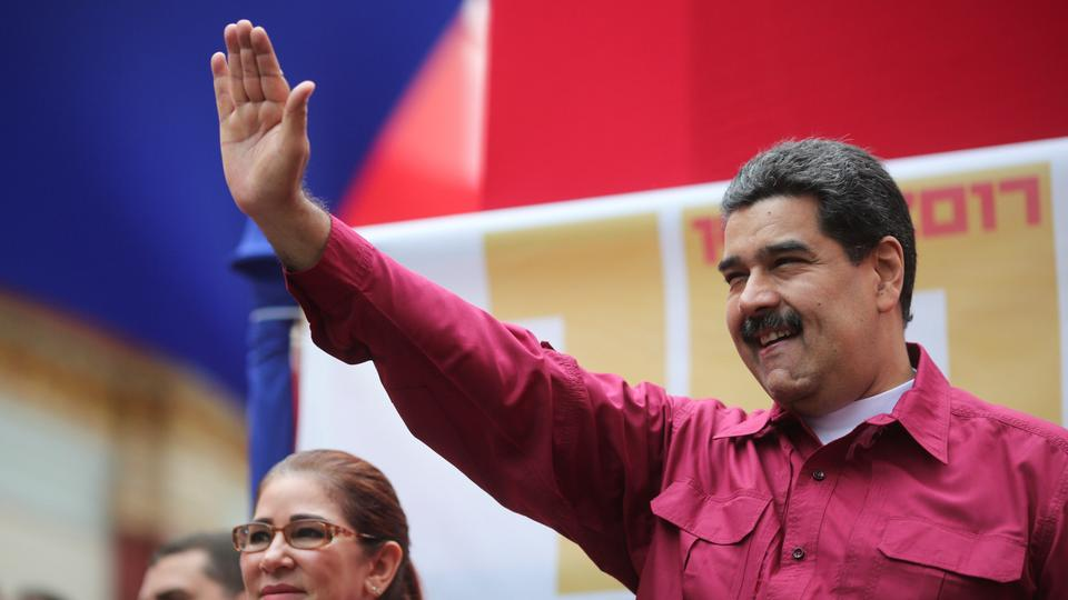 Venezuela's President Nicolas Maduro waves as he arrives for a rally with supporters in Caracas, Venezuela, November 7, 2017.