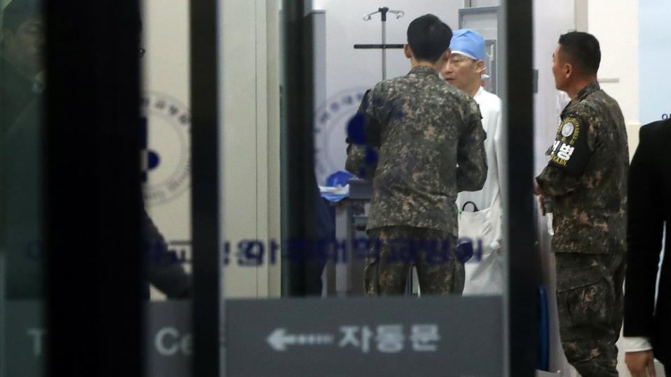 A South Korean soldier talks with a surgeon at a hospital where a North Korean soldier who defected to the South after being shot and wounded by the North Korean military is hospitalized, in Suwon, South Korea, on November 13, 2017.