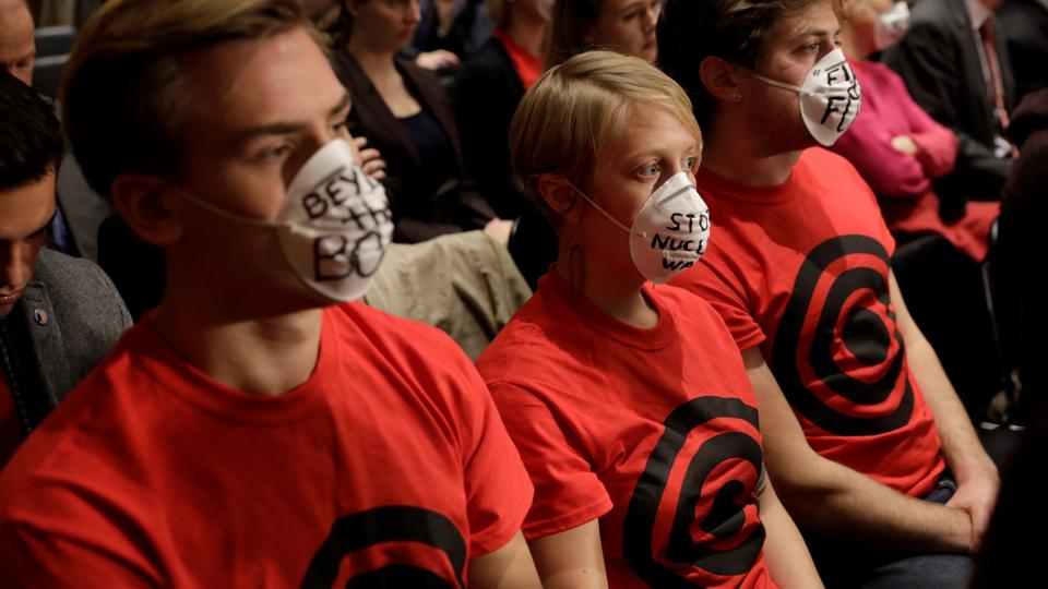 Anti-nuclear war protesters sit in a hearing of the US Senate Foreign Relations Committee about presidential authority to use nuclear weapons on Capitol Hill in Washington, November 14, 2017.