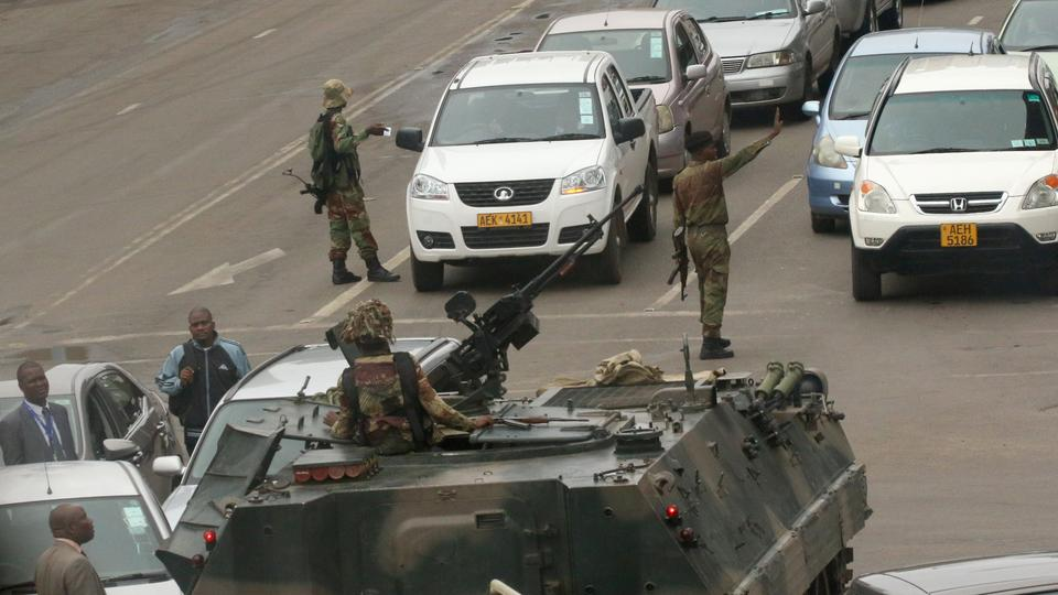 Military vehicles and soldiers patrol the streets of Zimbabwe's capital Harare on November 15,2017.