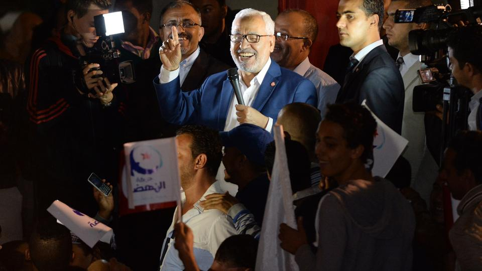 Rached Ghannouchi, the co-founder and lifelong leader of Tunisia's Ennahda movement, is able to develop an understanding between Islam and democratic values. That has helped his movement survive in the harsh realities of Arab politics. He gives a speech during the legislative election on October 27, 2014.