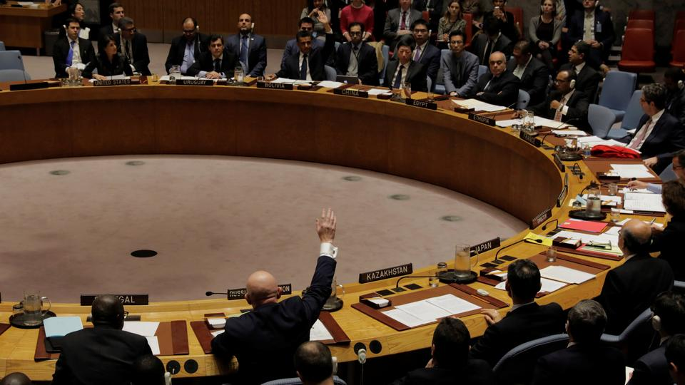 Representatives of Russia and Bolivia vote in the UN Security Council on a bid to renew an international inquiry into chemical weapons attacks in Syria during a meeting at the UN headquarters in New York.
