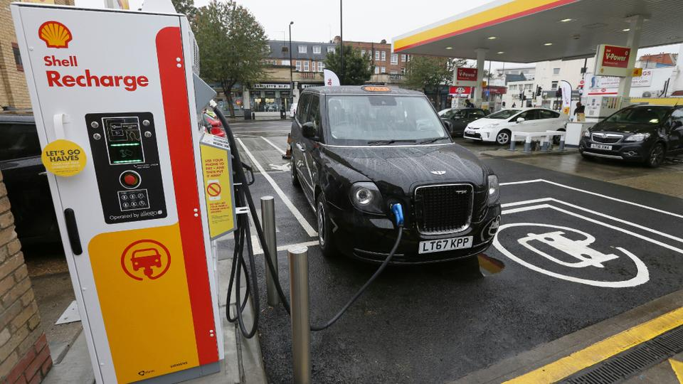 A New Tx Cab London Taxi Is Plugged Into Charging Station During Media Opportunity