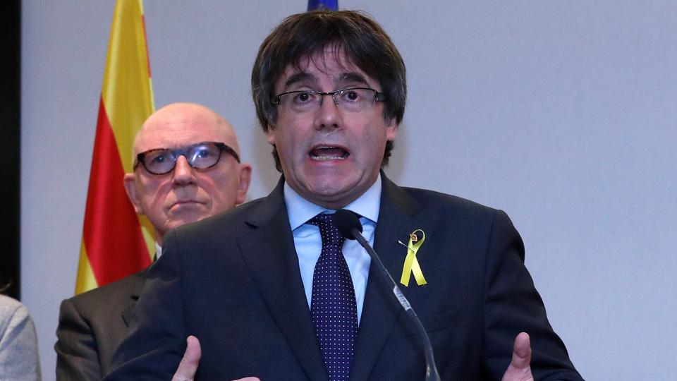 Ousted Catalan leader Carles Puigdemont (R) and his lawyer Paul Bekaert take part in a news conference in Brussels, Belgium, December 6, 2017.