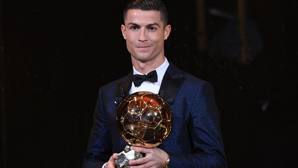 Cristiano Ronaldo collected the trophy in a glitzy ceremony at the Eiffel Tower in the French capital, presented by former France player David Ginola, on December 7, 2017.