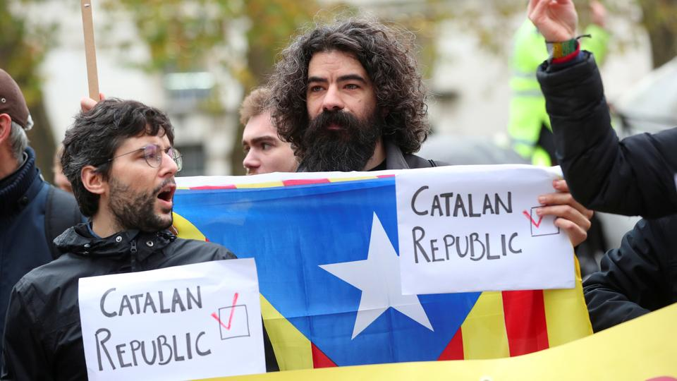 Protesters hold a Catalan separatist flag and placards outside Downing Street as Spain's Prime Minister Mariano Rajoy visits Britain's Prime Minister Theresa May, London, Britain, December 5, 2017.