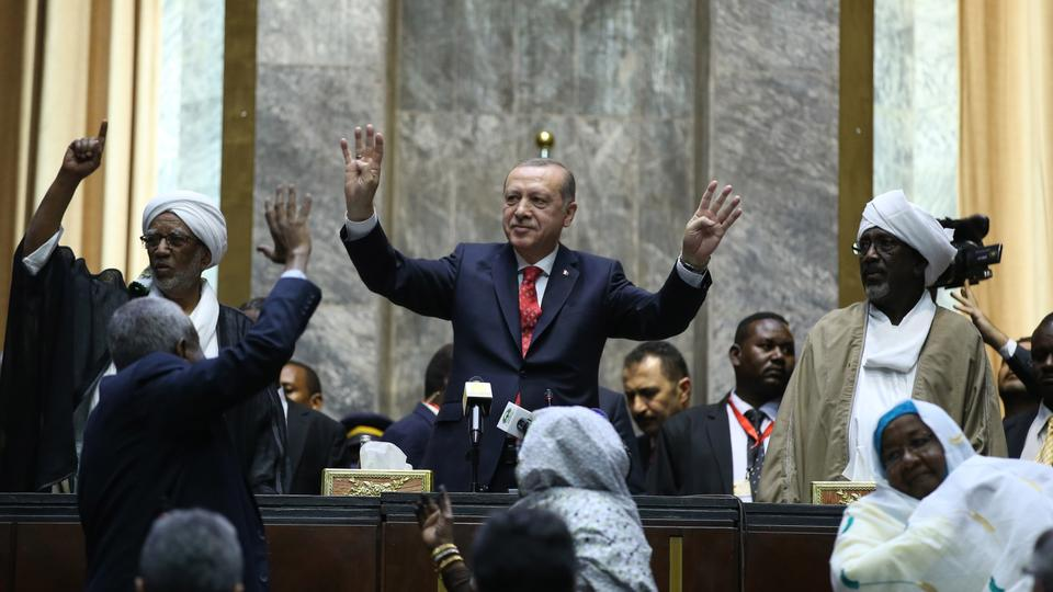 President of Turkey Recep Tayyip Erdogan greets members of parliament at the National Assembly of Sudan in Khartoum, Sudan on December 24, 2017.