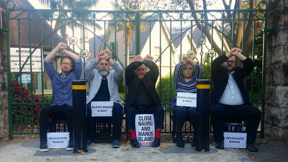 Five Christian community leaders, with chains around their necks attached to the main gate of Kirribilli House, which is the official residence of the Australian prime minister in Sydney, stage a protest in support of asylum seekers being held in transit centres on Manus Island in Papua New Guinea and Nauru on November 27, 2017.