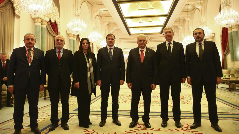 Prime Minister of Turkey BinaliYildirim(3rd R) poses for a photo with Turkey's Deputy Prime Minister Hakan Cavusoglu (C), Labour and Social Security Minister Julide Sarieroglu (3rd L), Health Minister Ahmet Demircan (2nd R), Justice and Development Party's Deputy Chairman and Spokesman Mahir Unal (R), Group Deputy Chairman Mustafa Elitas (2nd L) and Istanbul Deputy Mustafa Sentop (L) ahead of a joint press conference at the King Saud Royal Guest Palace in Riyadh, Saudi Arabia on December 27, 2017.