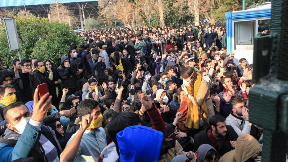 In this photo taken by an individual not employed by the Associated Press and obtained by the AP outside Iran, university students attend a protest inside Tehran University while anti-riot Iranian police prevent them from joining other protestors in Tehran, Iran. December 30, 2017.