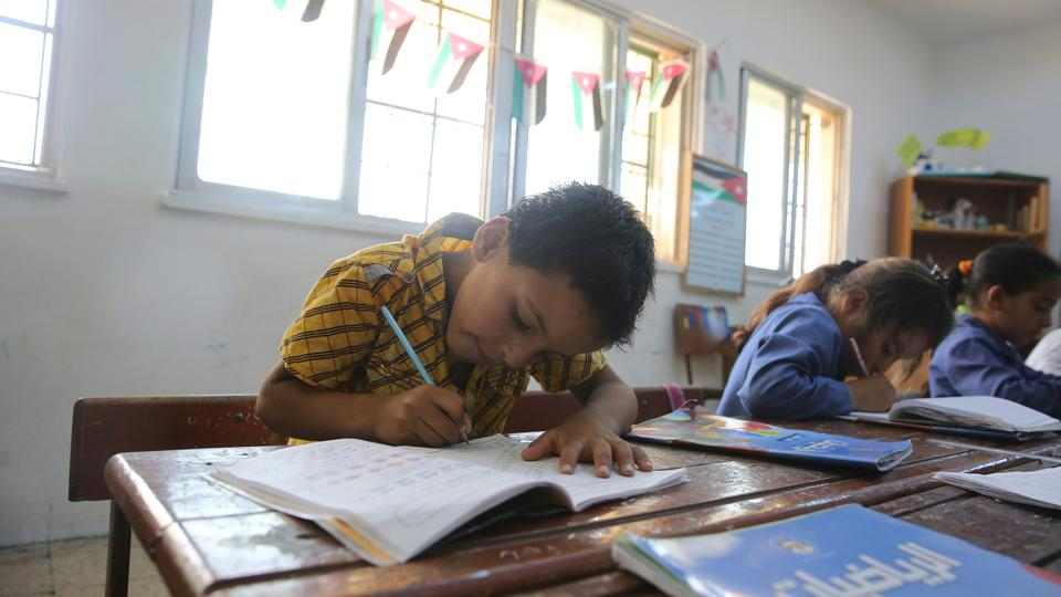 A Syrian refugee boy during a lesson at a summer school in Amman, Jordan, July 20, 2017.