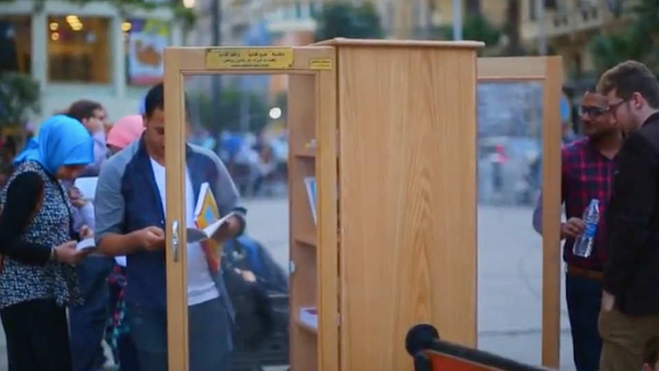 Screenshot of people at a street library, Cairo, Egypt.