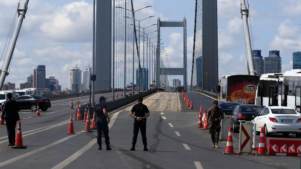 Turkish police officers secure the July 15 Martyr's bridge ahead of a ceremony to commemorate the anniversary of the July 15, 2016 coup attempt, in Istanbul, July 15, 2017.