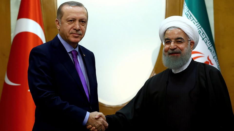 Turkish President Recep Tayyip Erdogan (L) and Iran's President Hassan Rouhani shaking hands before a meeting with Russia's President Vladimir Putin, in Sochi, Russia, November 22, 2017.