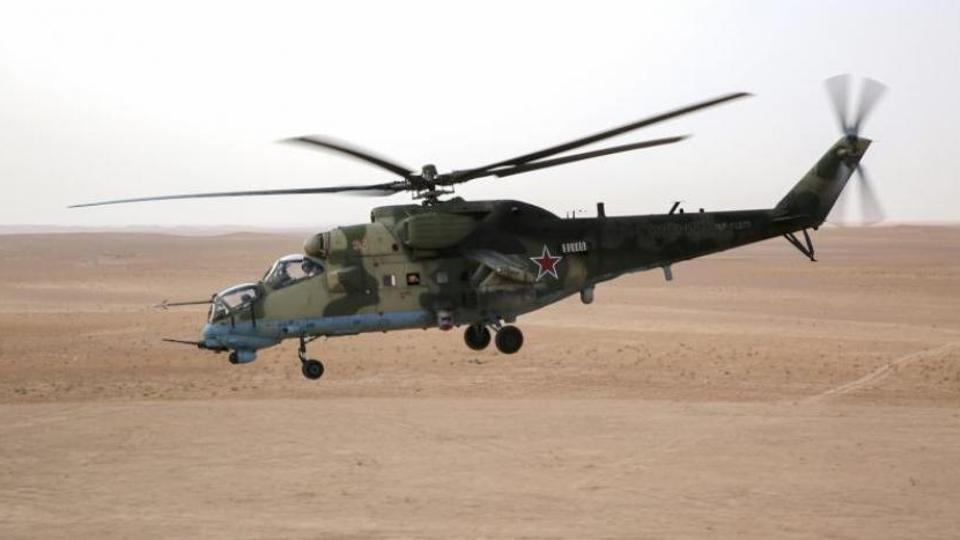 The helicopter had reportedly tripped over power line wires and crashed while escorting a convoy.