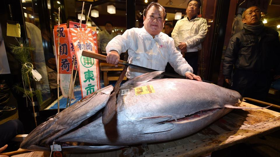 Japan's famous Tsukiji fish market holds final auction before Olympics