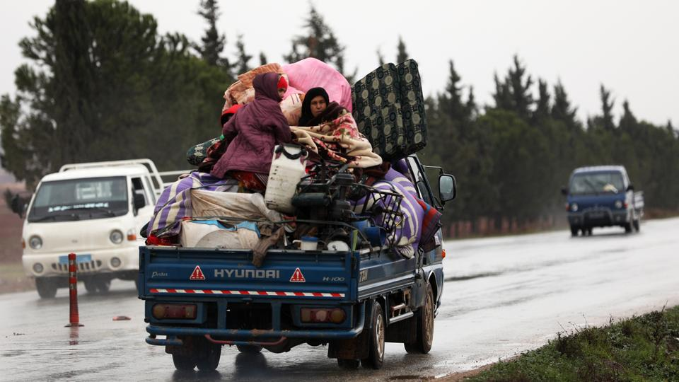 Syrian regime forces press Idlib offensive as people flee homes