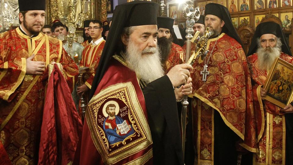 jerusalems greek orthodox patriarch theophilos iii c attends a christmas service according to the