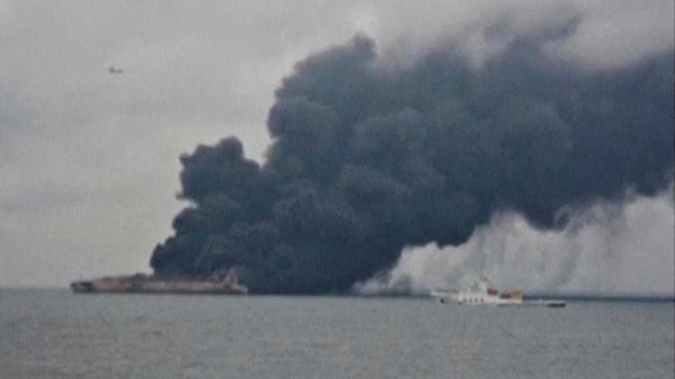 Smoke is seen from Panama-registered tanker SANCHI carrying Iranian oil after it collided with a Chinese freight ship in the East China Sea, in this still image taken from a January 7, 2018 video.