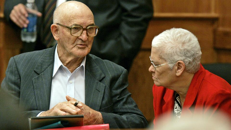 In this June 20, 2005 photograph, Edgar Ray Killen confers with his wife Betty Jo Killen, in Philadelphia, Mississippi, during a recess of his murder trial for the 1964 slayings of three civil rights workers.