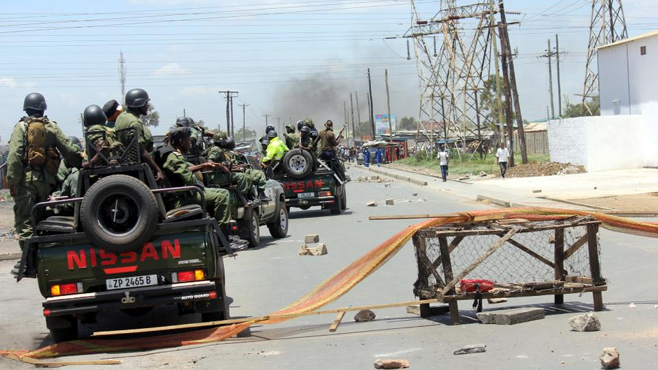 Zambian police forces patrol the streets of Lusaka's Kanyama Township on January 12, 2018, during clashes with protesters demonstrating against a curfew and a ban on street commerce imposed by the government in the wake of a cholera outbreak.