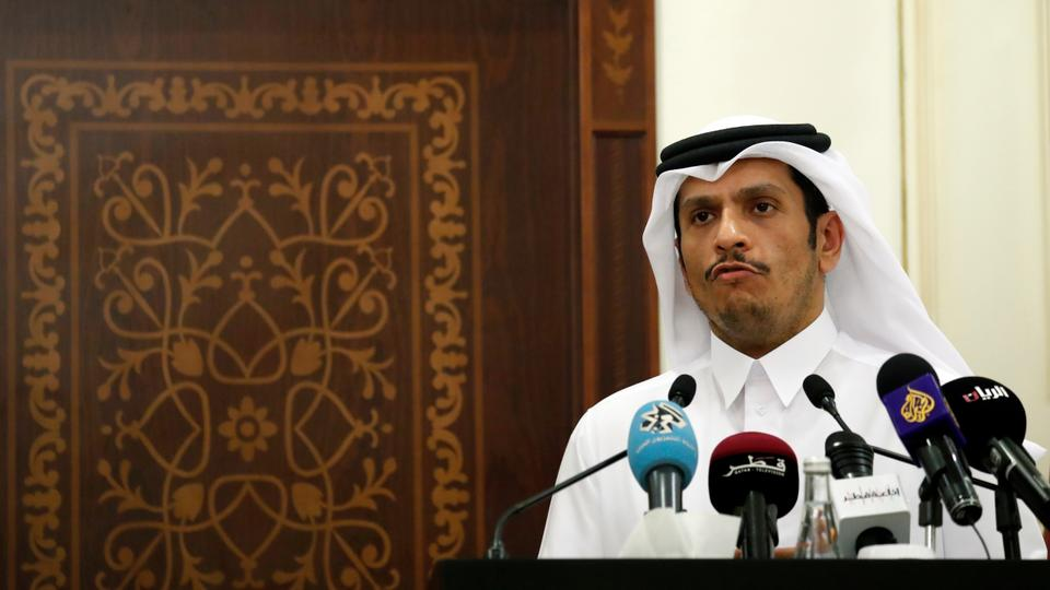 Qatar's Foreign Minister Sheikh Mohammed bin Abdulrahman Al Thani listens to a reporter's question during a press conference.