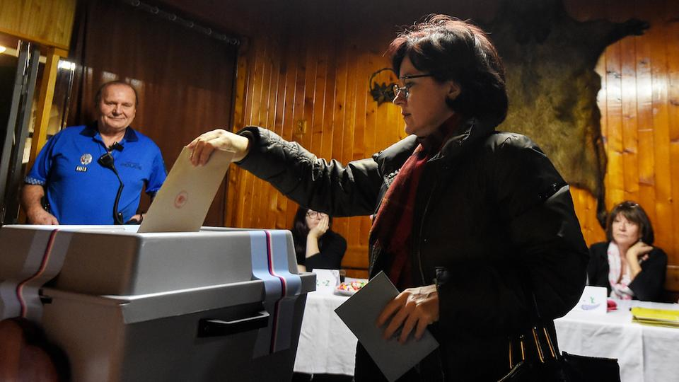 A woman casts her ballot during the first round of the presidential election at a polling station on January 12, 2018 in Prague. The first round of the presidential election will be held on January 12 and 13, 2018.