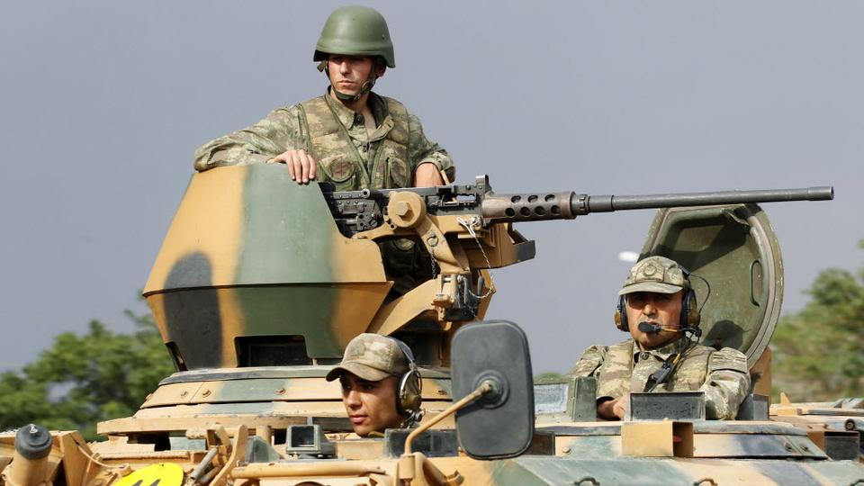 File photo shows Turkish soldiers on an armored personnel carrier as part of a Turkish military convoy.