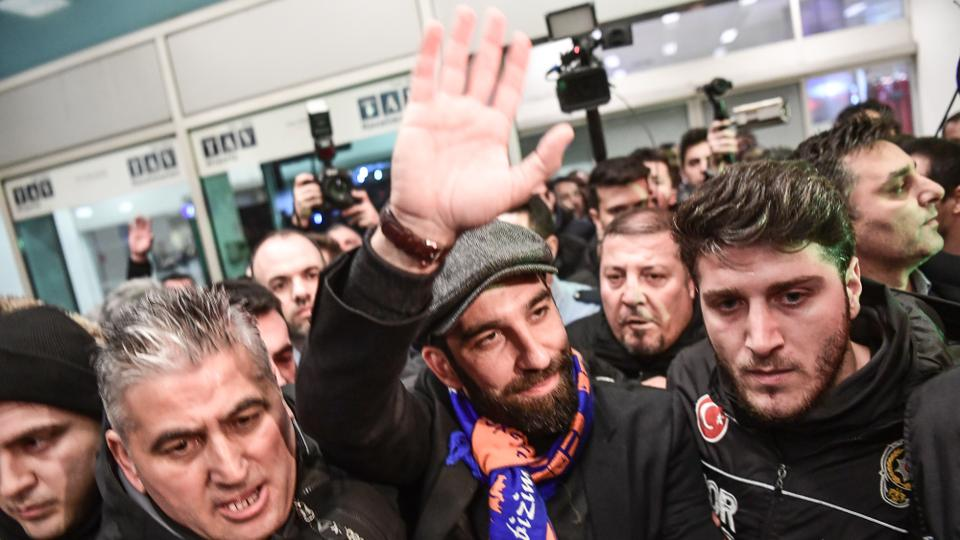 Barcelona football club's Turkish midfielder Arda Turan waves to supporters as he arrives at the Ataturk International Airport in Istanbul. January 13, 2018.